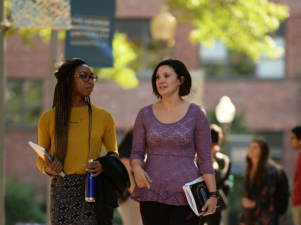Chellese and Caitlyn walk in University Yard
