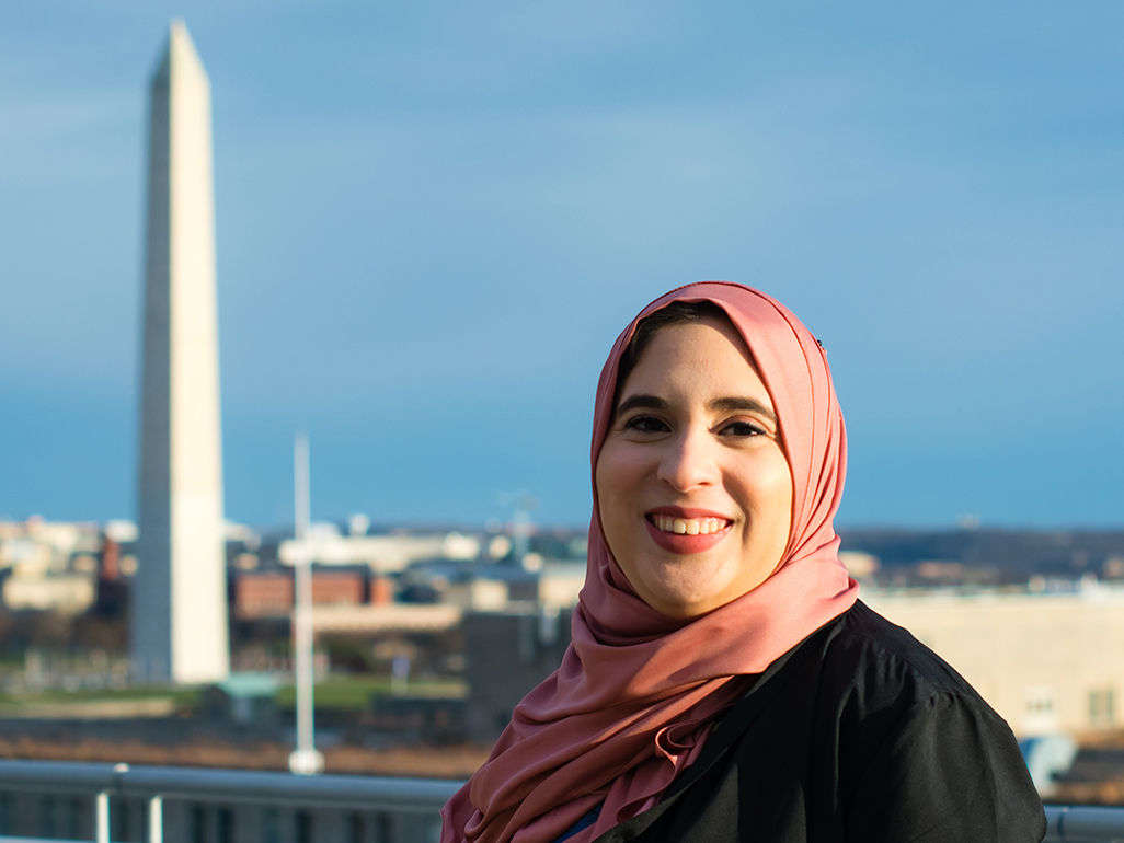 Hajar stands with Washington Monument in background
