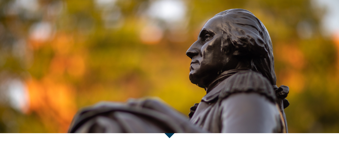 Statue of George Washington with fall leaves behind