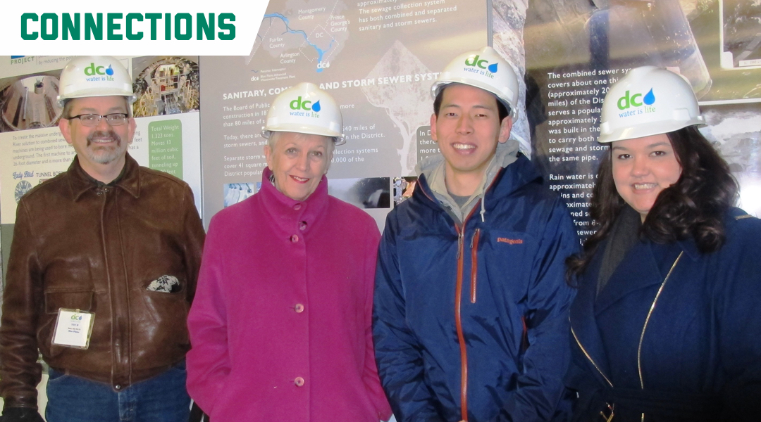 Connections: Prof. Peter Linquiti and three students wear hard hats at DC Water