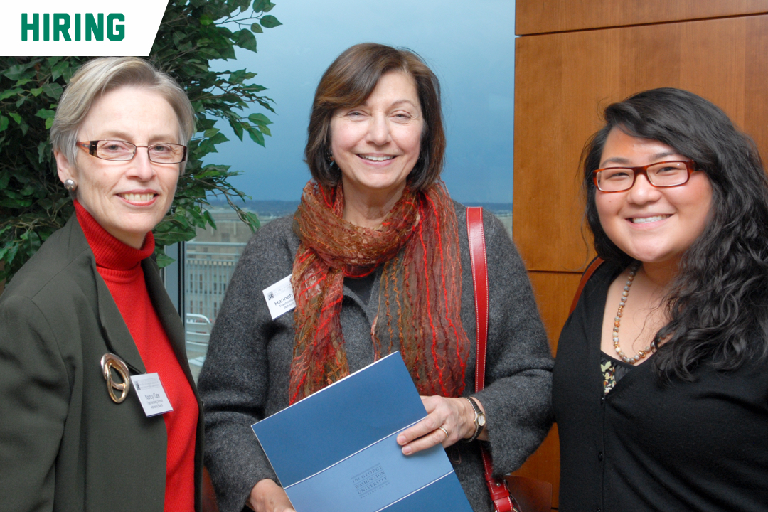 Hiring; Three women smiling with folders