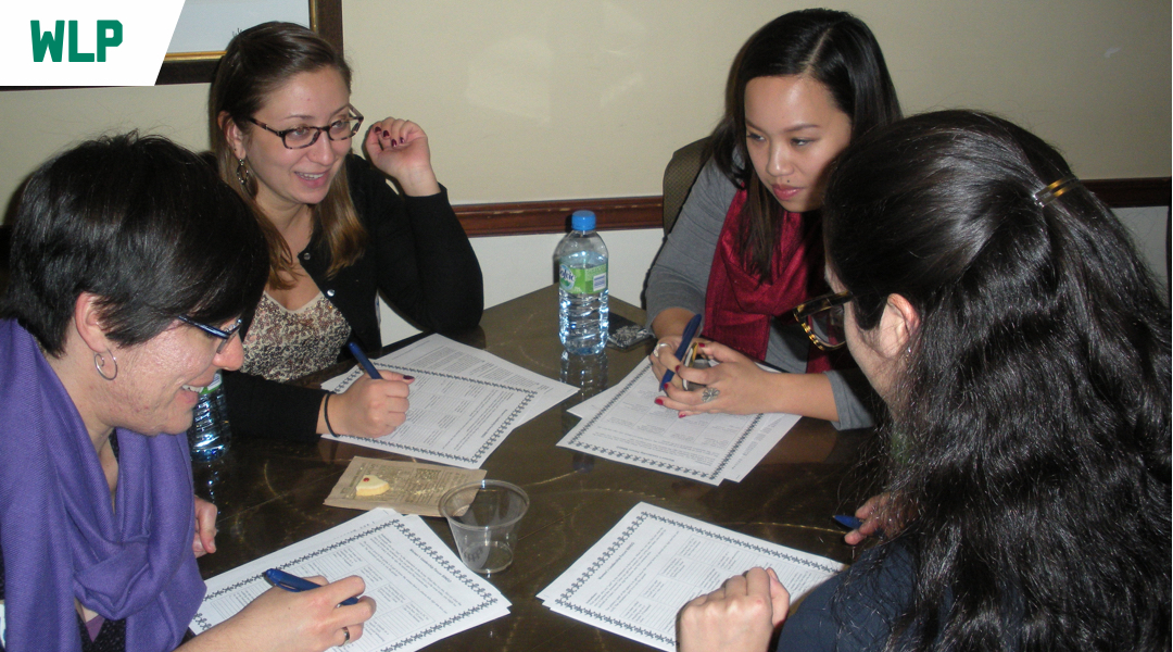 Four women work together during a Women's Leadership Fellows meeting